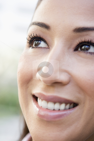 Close up of smiling woman stock photo, Close up of smiling woman smilling off camera by Monkey Business Images