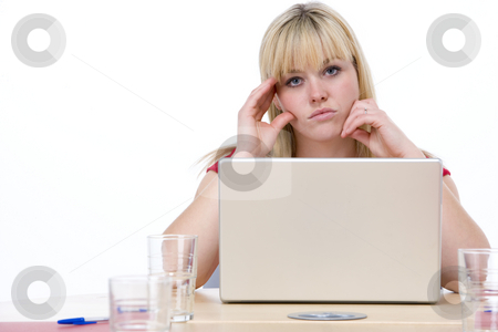 Businesswoman sitting in boardroom with laptop looking unhappy stock photo,  by Monkey Business Images