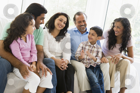 A Middle Eastern family sitting together on a couch stock photo,  by Monkey Business Images