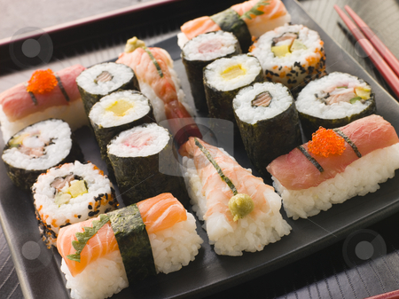 Selection of Seafood and Vegetable Sushi on a Tray stock photo, Selection of Seafood and Vegetable Sushi on a Tray with chopsticks by Monkey Business Images