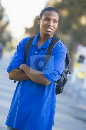 University student with rucksack outside stock photo, Male university student off campus by Monkey Business Images
