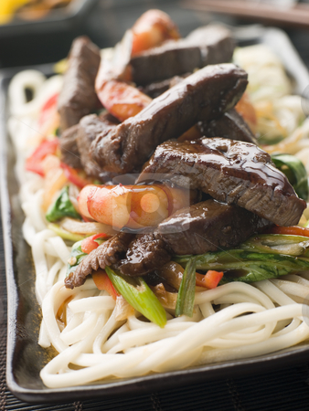Teriyaki Beef Fillet and Tiger Prawns with Udon Noodles stock photo, Plate of Teriyaki Beef Fillet and Tiger Prawns with Udon Noodles by Monkey Business Images