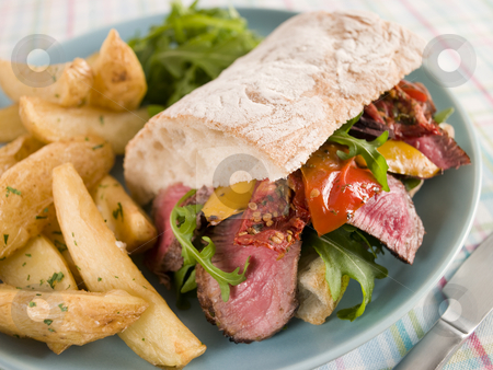 Steak and Roasted Pepper Ciabatta Sandwich with Spiced Potato We stock photo, Plate of Steak and Roasted Pepper Ciabatta Sandwich with Spiced Potato Wedges by Monkey Business Images