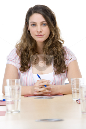 Businesswoman sitting in boardroom stock photo,  by Monkey Business Images