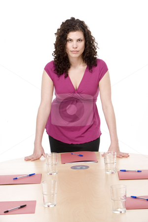 Businesswoman standing in boardroom stock photo,  by Monkey Business Images