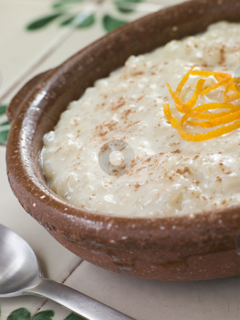 Orange and Cinnamon Rice Pudding stock photo,  by Monkey Business Images