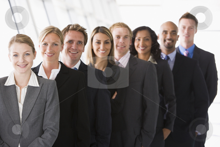 Line up of office staff stock photo, Line up of office staff facing camera by Monkey Business Images