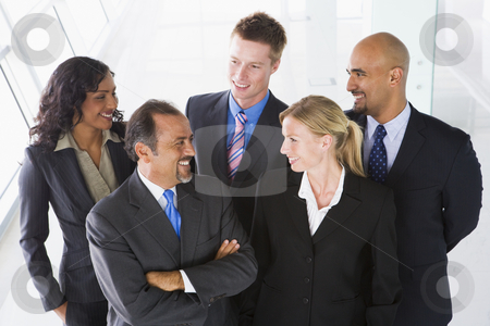 Overhead view of office staff stock photo, Overhead view of office staff chatting by Monkey Business Images