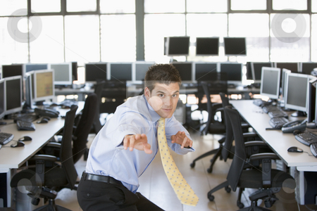 Businessman standing in karate stance in computer room stock photo,  by Monkey Business Images