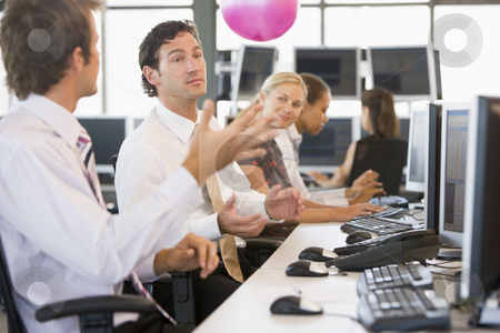 Five businesspeople in office space with a ball being thrown stock photo,  by Monkey Business Images