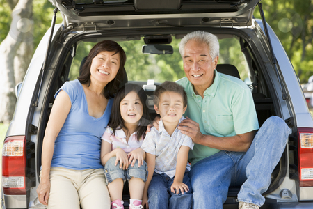 Grandparents with grandkids in tailgate of car stock photo,  by Monkey Business Images