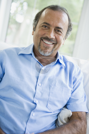 A Middle Eastern man at home stock photo,  by Monkey Business Images