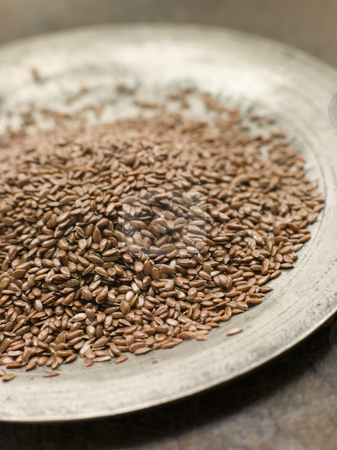 Brown Linseed on a Pewter Plate stock photo, Close up of Brown Linseed on a Pewter Plate by Monkey Business Images