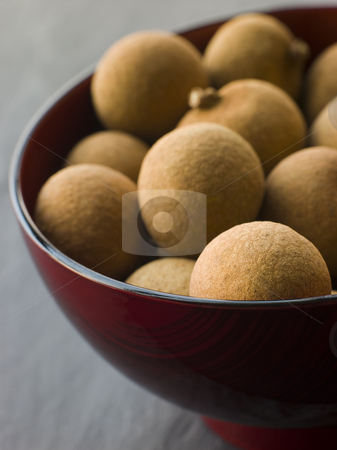 Longan in Wooden Bowl stock photo, Close up of Longan in Wooden Bowl by Monkey Business Images