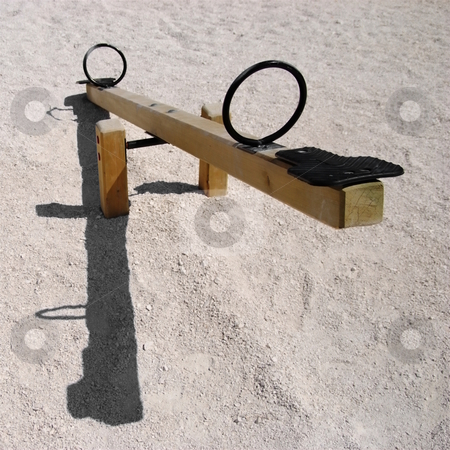Seesaw stock photo, Empty wooden teeter-totter or seesaw with shadow - negative natality concept by Milsi Art