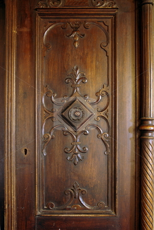 Vintage door stock photo, A picture of a wooden carved door of an antique closet by Milsi Art