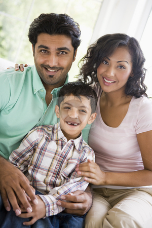 A Middle Eastern couple with their son stock photo,  by Monkey Business Images