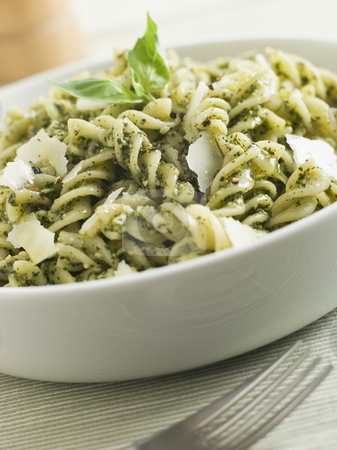 Bowl of Fusilli Pasta dressed in Pesto with Parmesan Shaves stock photo,  by Monkey Business Images