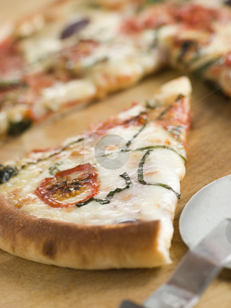 Slice of Tomato Mozzarella Aubergine and Basil Pizza stock photo,  by Monkey Business Images