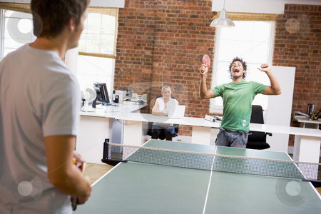 Two men in office space playing ping pong stock photo,  by Monkey Business Images