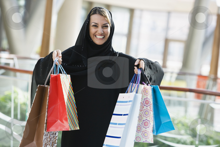 A Middle Eastern woman in a shopping mall stock photo,  by Monkey Business Images
