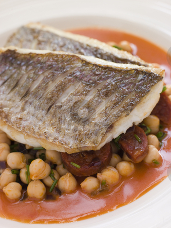 Fillets of Sea Bream with Chorizo Sausage Chickpeas and Tomato S stock photo,  by Monkey Business Images