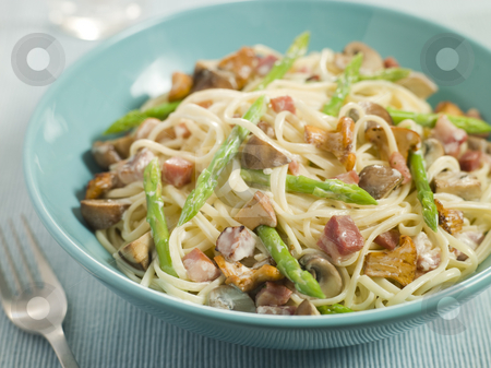 Linguine with Girolle Mushrooms Asparagus and Pancetta stock photo,  by Monkey Business Images