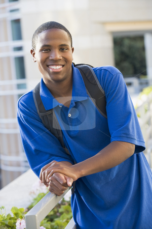 Male student outside stock photo, Male university student outside wearing rucksack by Monkey Business Images