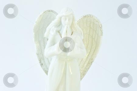 Angel statuette   stock photo, White porcelain angel statuette on white background. by Mariusz Jurgielewicz