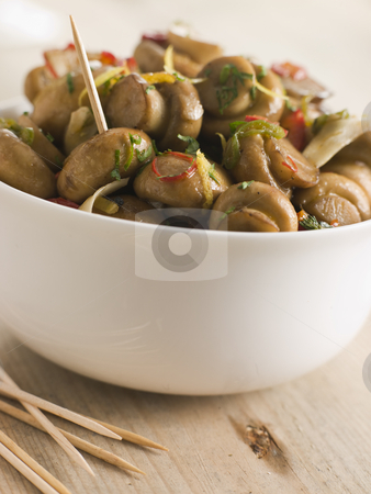 Championes al Ajillo- Chilli marinated Mushrooms stock photo,  by Monkey Business Images