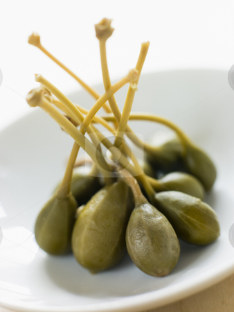 Dish of Caper Berries stock photo,  by Monkey Business Images