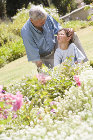 Grandfather and grandson working in the garden stock photo,  by Monkey Business Images