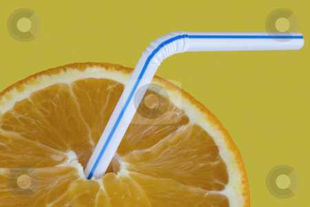 Orange drink stock photo, And orange with a drinking straw on an orange background by Stephen Gibson