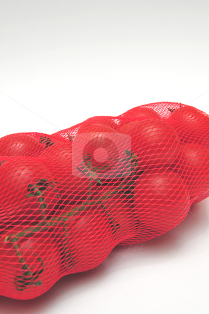 Cherry Tomatos And Mesh Bag stock photo, Small tomatos in a plastic mesh bag by Lynn Bendickson