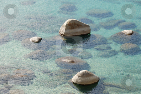 Rocks in Clear Lake Water stock photo, Rocks showing from clear lake water on a sunny day by Denis Radovanovic