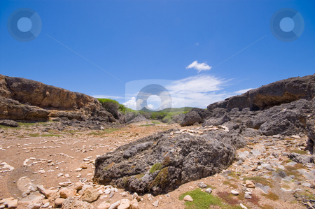 Rocky shore inlet shete boca national park  stock photo, Rocky shore shete inlet boca national park with view of cristoffel mountain curacao by Karin Claus