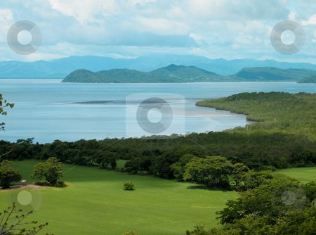 Green hill stock photo, Green pasture covered hill with sea vieuw by Karin Claus