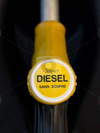 French yellow super diesel  pump  stock photo, French yellow super diesel  pump  closeup with black background by Laurent Dambies