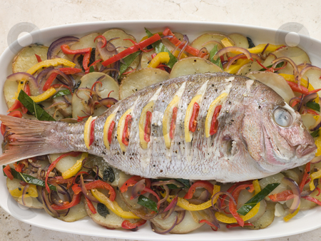 Whole Roasted Bream with Chilies Potatoes and Peppers stock photo,  by Monkey Business Images
