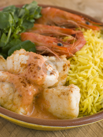 Saute of Monkfish Prawns and Rice with Pimento Cream stock photo,  by Monkey Business Images