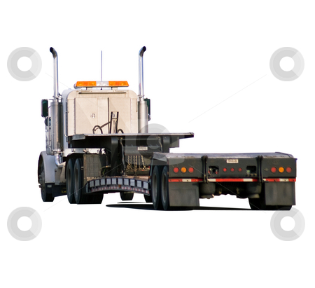 Big rig with drop-deck trailer stock photo, Heavy hauler looking for a load. Isolated with clipping path by RCarner Photography