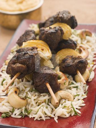 Cardamom Lamb Boti with Cashew Rice stock photo, Plate of Cardamom Lamb Boti with Cashew Rice by Monkey Business Images