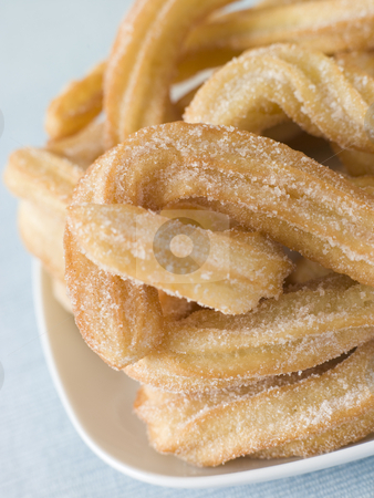 Plate of Churros stock photo,  by Monkey Business Images
