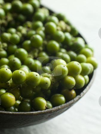 Green Peppercorns on the vine stock photo, Dish of Green Peppercorns on the vine by Monkey Business Images