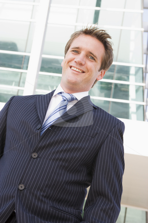 Businessman standing outdoors smiling stock photo,  by Monkey Business Images