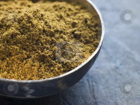Dish of Madras Curry Powder stock photo, Close up of Dish of Madras Curry Powder by Monkey Business Images