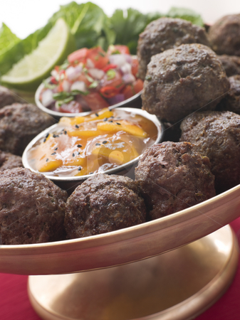 Platter of Kofta Balls with Mango Chutney and Tomato Relish stock photo,  by Monkey Business Images