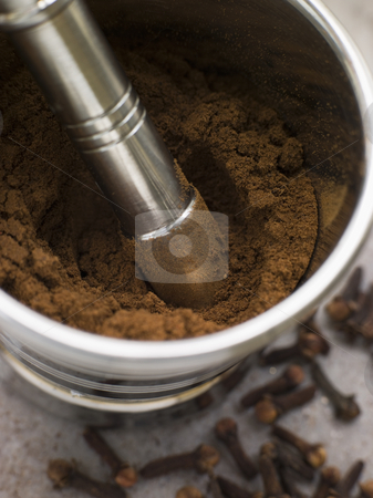 Ground Clove Powder in a Pestle and Mortar stock photo,  by Monkey Business Images