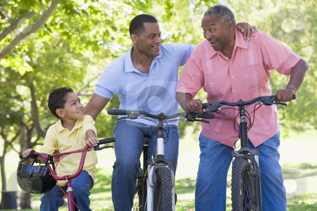 Grandfather grandson and son bike riding stock photo,  by Monkey Business Images