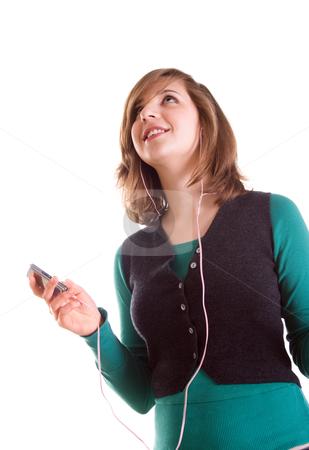 Blond teenager girl listening music stock photo, Blond teenager girl listening music on her MP3 player by Mikhail Lavrenov